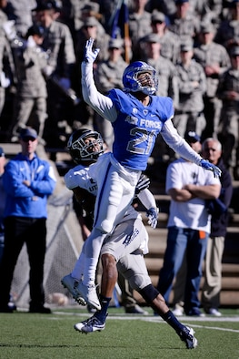 Air Force Falcons cornerback Jesse Washington goes airborne to defend a pass against Utah State, Nov. 14, 2015, at Falcon Stadium. Air Force beat the Aggies 35-28. (U.S. Air Force photo/Mike Kaplan)