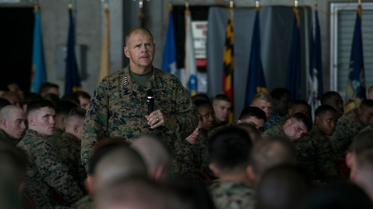 """The 37th Commandant of the Marine Corps, Gen. Robert B. Neller, speaks to service members during a Nov. 23 visit to Marine Corps Air Station Futenma, Okinawa. The CMC and Sgt. Maj. of the Marine Corps Ronald L. Green visited service members with III Marine Expeditionary Force, the """"tip of the spear,"""" in the Asia-Pacific region by travelling around and speaking with forward deployed Marines across the installations that comprise Marine Corps Base Camp Smedley D. Butler, Okinawa, Japan. The Marines and sailors of III MEF are faithfully committed to a force posture in the Asia-Pacific that is operationally ready and geographically dispersed, responsive to the requirements of the Japan/U.S. defense alliance."""