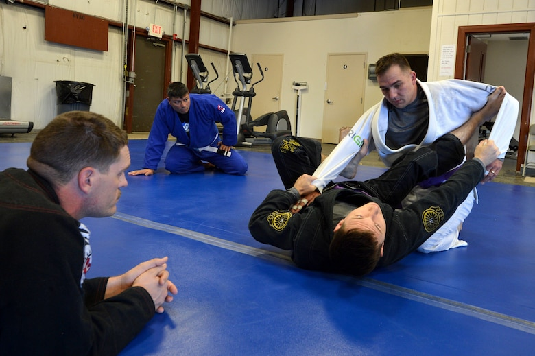 A Combatives House jiu-jitsu instructor performs ground techniques on a student during training at Shaw Air Force Base, S.C., Nov. 14, 2015. The classes are open to all skill levels and groups and squadrons are encouraged to use the facility during its open hours to perform group physical training. (U.S. Air Force photo by Senior Airman Diana M. Cossaboom)