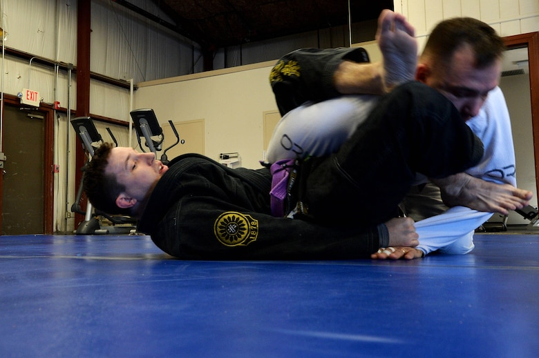 A Combatives House jiu-jitsu instructor performs ground techniques on a student during training at Shaw Air Force Base, S.C., Nov. 14, 2015. Classes and equipment are open to anyone who can get on base except for the Army Level I and II Combatives training and boxing which are open to military members only. (U.S. Air Force photo by Senior Airman Diana M. Cossaboom)