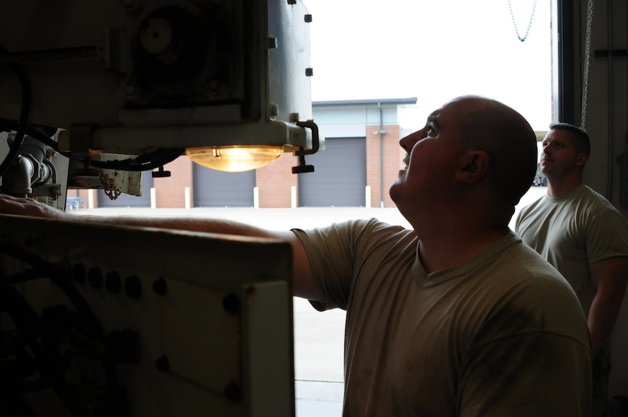 Senior Airman Aaron Russell, vehicle mechanic, and Tech. Sgt. Christopher Corbit, vehicle mechanic, operate on a Zim mixer Oct. 7, 2015, at Ebbing Air National Guard Base, Fort Smith, Ark. Airmen within Vehicle Maintenance handle all maintenance concerns for registered vehicles and technical support for ex-registered vehicles. (U.S. Air National Guard photo by Senior Airman Cody Martin/Released)