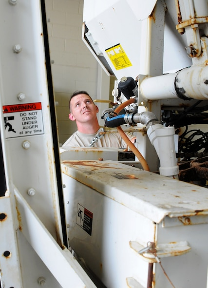 Tech. Sgt. Christopher Corbit, vehicle mechanic, operates on a Zim mixer Oct. 7, 2015, at Ebbing Air National Guard Base, Fort Smith, Ark.  Airmen within Vehicle Maintenance handle all maintenance concerns for registered vehicles and technical support for ex-registered vehicles. (U.S. Air National Guard photo by Senior Airman Cody Martin/Released)