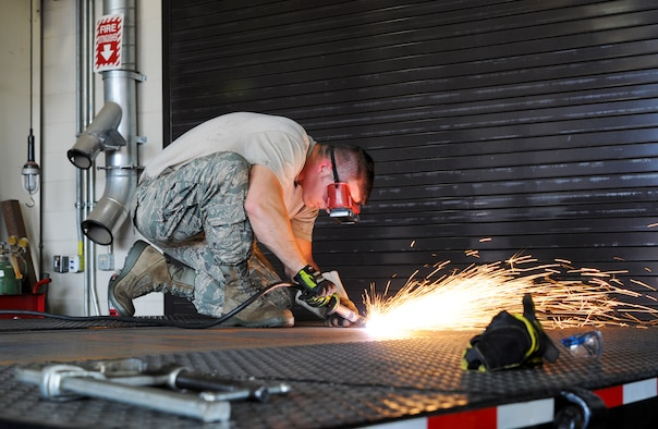 Tech. Sgt. Christopher Corbit, vehicle mechanic, uses a plasma cutter at Ebbing Air National Guard Base, Fort Smith, Ark., to remove eyelets Sept. 1, 2015. Airmen within Vehicle Maintenance handle all maintenance concerns for registered vehicles and technical support for ex-registered vehicles. (U.S. Air National Guard photo by Senior Airman Cody Martin/Released)