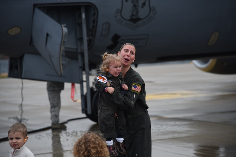 Maj. Sharon Gilliand, a KC-135 Stratotanker pilot with the 108th Wing, receives a celebratory spraying from her husband Maj. Kiel Gilliand, children Garrett and Lacey, fellow pilots and crew members following her final flight for the 108th Wing at Joint Base Mcguire-Dix-Lakehurst on Nov. 5, 2015. Gilliland, a pilot for 12 years with the New Jersey Air National Guard's 108th Wing is ceremonially hosed down as she leaves piloting to others and takes a non-flying job with the 514th AMOS, Air Force Reserve so she can devote more time to her family. During her time in the 108th Wing, Gilliland deployed three times and has 60 combat sorties to her credit. (U.S. Air National Guard photo by Master Sgt. Carl Clegg/Released)