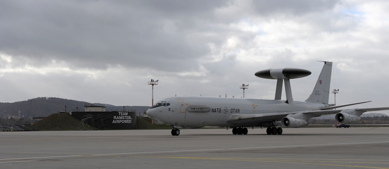 An E-3 Sentry airborne warning and control system (AWACS) aircraft assigned to the E-3A Component at NATO Air Base Geilenkirchen, Germany taxis on to the flightline Nov. 18, 2015, at Ramstein Air Base, Germany. The NATO AWACS visited Ramstein in order to familiarize NATO Allied Air Command (AIRCOM) leadership with its capabilities as the E-3A Component is scheduled to come under operational command of AIRCOM in fall 2016. (U.S. Air Force photo/Staff Sgt. Timothy Moore)