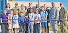 Governor Sam Brownback, Maj. Gen. Wayne W. Grigsby Jr., 1st Infantry Division and Fort Riley commanding general, join a host of other Fort Riley leaders and school children at the Fort Riley Elementary School's official ribbon-cutting ceremony Oct. 9.