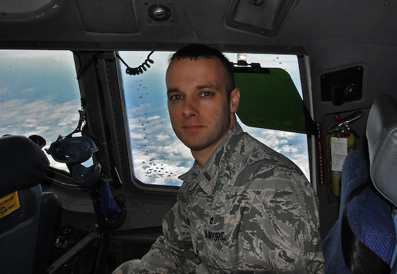 2nd Lt. Chris Long rides behind the copilot in a C-17 Globemaster III, while on his first mission as a public affairs specialist with the 315th Airlift Wing.  THe jet was on a training mission to San Juan, Puerto Rico earlier this month. (U.S. Air Force Photo by Maj. Wayne Capps)