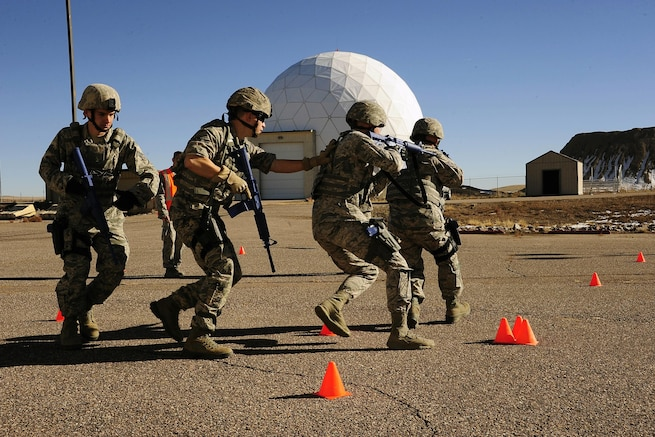 Colorado Air National Guardsmen conduct training on Buckley Air Force Base, Colo., Nov. 15, 2015. The airmen are assigned to the 140th Security Forces Squadron. Colorado National Guard photo by Air Force Tech. Sgt. Nicole Manzanares
