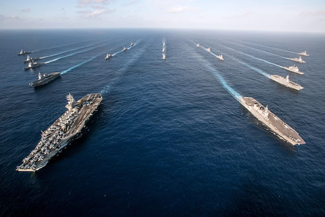 The Ronald Reagan Carrier Strike Group steams in formation with Japan Maritime Self-Defense Force ships during a photo exercise in the Pacific Ocean, Nov. 23, 2015. The ships were participating in an annual training exercise aimed at increasing interoperability between Japanese and American forces. U.S. Navy photo by Petty Officer 3rd Class Nathan Burke