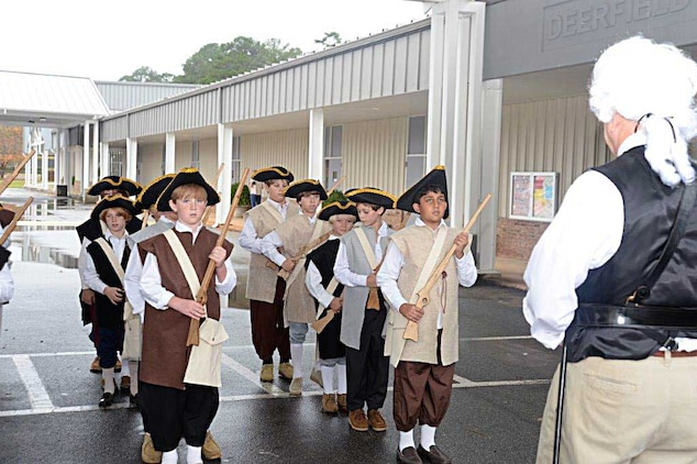 Kent Morrison, executive director, Marine Corps Logistics Base Albany, spends part of Nov. 19 helping fifth grade students at Deerfield-Windsor's Lower School, Albany, Ga., learn about the American Revolution.