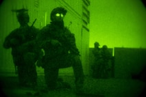Marine Raiders with Marine Special Operations Company Charlie, 1st Marine Raider Battalion, U.S. Marine Corps Forces, Special Operations Command, set up a cordon around the perimeter of a building, while conducting a notional direct-action night raid, during a Company Collective Exercise, Oct. 17, 2015, in Florence, Ariz.