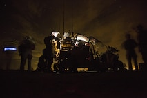 Marine Raiders with Marine Special Operations Company Charlie, 1st Marine Raider Battalion, U.S. Marine Corps Forces, Special Operations Command, process intelligence and set up a visual tele-communication feed after a notional direct-action night raid, a part of a Company Collective Exercise, Oct. 20, 2015, along the Arizona-California state line.