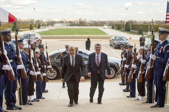 U.S. Defense Secretary Ash Carter hosts an honor cordon welcoming French Defense Minister Jean-Yves Le Drian to the Pentagon, Nov. 24, 2015. The two leaders met to discuss matters of mutual interest. DoD photo by Air Force Senior Master Sgt. Adrian Cadiz