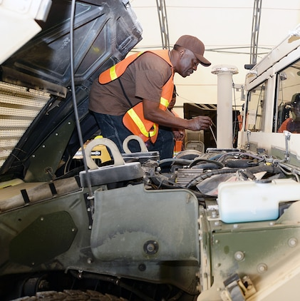 Melvin Williams, mechanic, Marine Corps Logistics Command, checks the fluid level on a vehicle recently while performing the level A preservation process aboard Marine Corps Logistics Base Albany. This is one step in an extensive process to help prevent deterioration of vehicles stored outside.