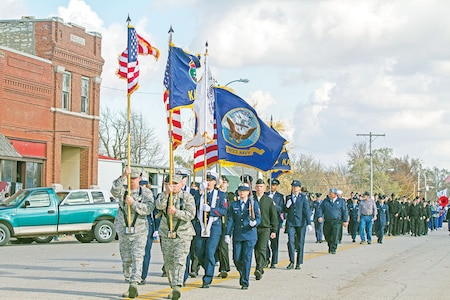 Soldiers of the 1st Infantry Division Sustainment Brigade marched Nov. 11 in the Eskridge Veterans Day Parade and Salute in Eskridge, Kansas. Soldiers of the 1st Inf. Div. Sust. Bde. are partnered with, volunteer for, and support the schools in the local communities of Alta Vista, Alma, Paxico, Maple Hill and Eskridge, all within Wabaunsee County, Kansas.