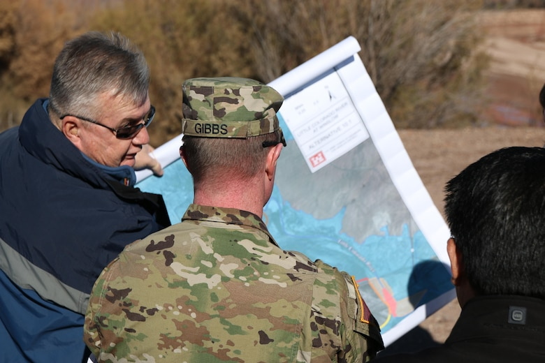 Brian Kenny (left), a project manager with the Arizona-Nevada Area Office, discusses flood mitigation with Los Angeles District Commander Col. Kirk Gibbs Nov. 20. Kenny explained several features under consideration for the 7.2 mile flood control levee located along the Little Colorado River near Winslow, Arizona.