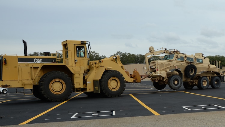 William Palmer, engineering equipment operator, Marine Corps Logistics Command, prepares to park a mine-resistant ambush protected vehicle in an incoming equipment lot. The vehicle was requested by Production Plant Albany staff to be rebuilt.