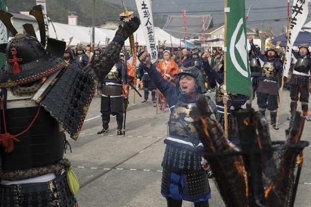 Participants give one last war cry before marching off at the Kuragake Castle Festival in Kuga, Iwakuni, Japan, Nov. 22, 2015. The festival honors the local Kuga samurai who urged their castle lord to take a last stand against a much larger enemy force. According to event coordinators, U.S. participants in the 26th annual Kuragake Castle Festival boosted the spirit of the festival and made the stage performance one of their most highlighted events.