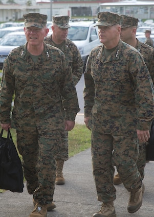 "Lt. Gen. Larry Nicholson, the commanding general of III Marine Expeditionary Force, left, greets the 37th Commandant of the Marine Corps, Gen. Robert B. Neller, right, as they walk to the Camp Hansen Theater Nov. 23, 2015. Neller and the Sgt. Maj. of the Marine Corps Ronald L. Green visited III Marine Expeditionary Force, the ""tip of the spear,"" in the Asia-Pacific region by travelling around and speaking with forward deployed Marines across the installations that comprise Marine Corps Base Camp Smedley D. Butler, Okinawa, Japan. The Marines and sailors of III MEF are faithfully committed to a force posture in the Asia-Pacific that is operationally ready and geographically dispersed, responsive to the requirements of the Japan/U.S. defense alliance."