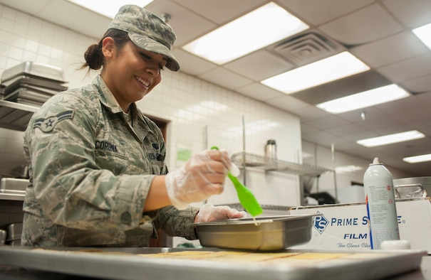Airman 1st Class Natalie Corona, 99th Force Support Squadron food service apprentice, prepares garlic bread to be served for dinner at the Crosswinds Dining Facility on Nellis Air Force Base, Nev., Nov. 18, 2015.  The Crosswinds DFAC will be serving Thanksgiving meals to Airmen and Department of Defense ID cardholders on Thanksgiving Day, Nov. 26. (U.S. Air Force photo by Senior Airman Mikaley Kline)
