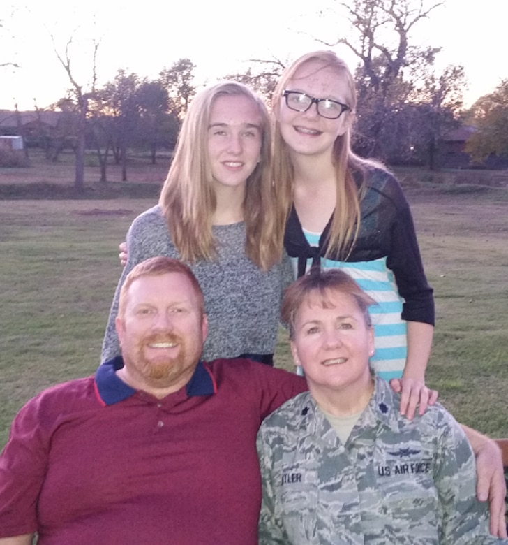 Lt. Col. Elizabeth Kettler (lower right) poses with her husband, Scott, and daughters, Connie (upper left) and Katie (upper right).