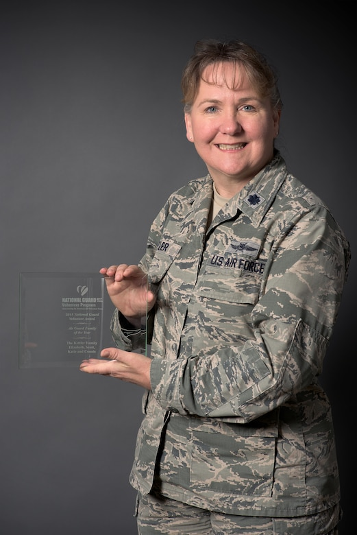 Lt. Col. Elizabeth Liz Kettler, 137th Air Refueling Wing Information Protection Chief, poses with the 2015 Air National Guard Family of the Year award.