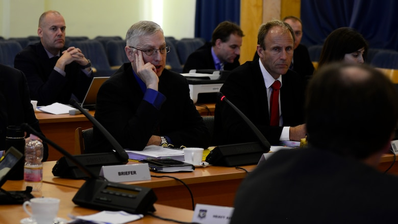(Middle) U.S. Air Force Brig. Gen. Mark Camerer, Strategic Airlift Capability Steering Board chairman, and Swedish Armed Forces Col. Olle Hultgren, NATO Airlift Management Programme Board chairman, speak to members of the combined Steering Board and Programme Board, Nov. 18, 2015, at Pápa Air Base, Hungary. Biannual meetings are held to bring the 12 member nations together to make decisions regarding the financial and operational aspects of the SAC Program. (U.S. Air Force photo by Senior Airman Areca T. Bell/Released)