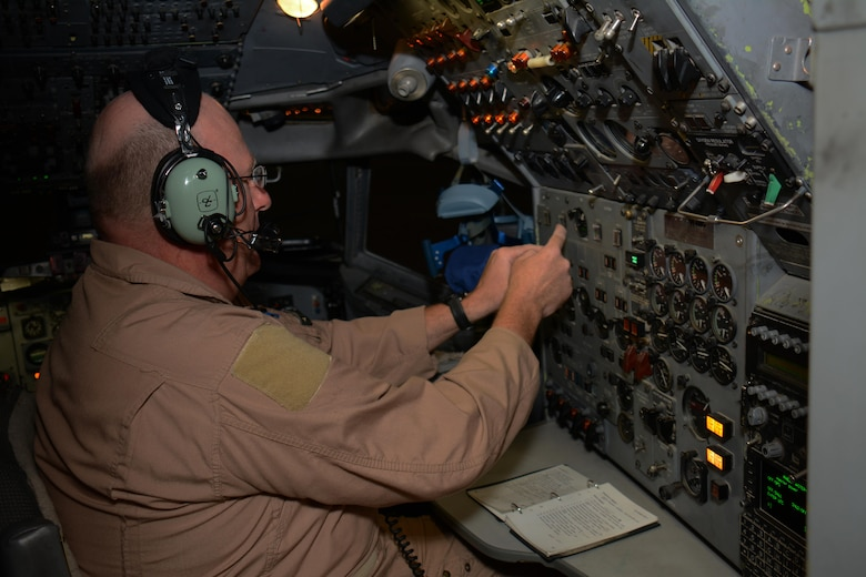 Master Sgt. Curtis Stark, 7th Expeditionary Airborne Command and Control Squadron superintendent, conducts a pre-flight inspection in the cockpit of an E-8C Joint Surveillance Target Attack Radar System aircraft at Al Udeid Air Base, Qatar Nov. 14. Stark has deployed 17 times with JSTARS aircraft in support of contingency operations and has accumulated more than 4,000 combat flying hours. After nearly 30 years of service he plans to retire from the Air Force in March 2016. (U.S. Air Force photo by Tech. Sgt. James Hodgman/Released
