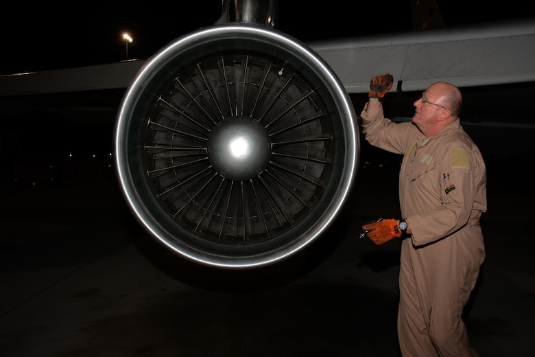 Master Sgt. Curtis Stark, 7th Expeditionary Airborne Command and Control Squadron superintendent, conducts a pre-flight inspection on the exterior of an E-8C Joint Surveillance Target Attack Radar System aircraft at Al Udeid Air Base, Qatar Nov. 14. Stark has deployed 17 times with JSTARS aircraft in support of contingency operations and has accumulated more than 4,000 combat flying hours. After nearly 30 years of service he plans to retire from the Air Force in March 2016. (U.S. Air Force photo by Tech. Sgt. James Hodgman/Released)