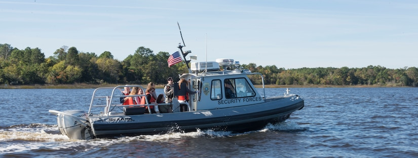 Riding on security forces boats, the Joint Base Charleston senior leadership spouses toured JB Charleston – NWS, S.C. they saw the Navy Nuclear Power Training school's submarines on Nov. 20, 2015. Because each boat's capacity was  a maximum of 10 people per boat, the spouses were divided into three separate groups. (U.S. Air Force photo/Airman 1st Class Thomas T. Charlton)