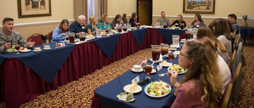 Chief Master Sgt. Mark Bronson, 628th ABW command chief, Col. Robert Lyman, 628th Air Base Wing commander and Cmdr. David Tarwater, Joint Base Charleston Naval Support Activity executive officer, have lunch with the JB Charleston spouses at the Red Bank Club at JB Charleston – NWS, S.C., on Nov. 20, 2015. The spouses were participating in the tour to get a different perspective of JB Charleston and be able to provide constructive feedback about possible improvements. (U.S. Air Force photo/Airman 1st Class Thomas T. Charlton)