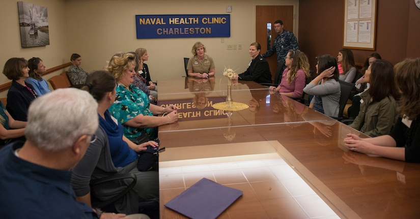 Navy Captain Annie  Maley, Naval Health Clinic Charleston commanding officer, welcomes the Joint Base Charleston senior leadership spouses with a briefing describing operations at the NHCC on JB Charleston – NWS, S.C., on Nov. 20, 2015. Maley explained that no matter your branch of service, the Air Force and Naval Health Clinics treat any military members. (U.S. Air Force photo/Airman 1st Class Thomas T. Charlton)
