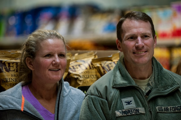 U.S. Air Force Col. Steven Horton, 52nd Fighter Wing vice commander, and his wife watch the 2015 Commissary Sweep at Spangdahlem Air Base, Germany Nov. 23, 2015. The Spangdahlem Spouses and Enlisted Members Club hosted the event as a way to give back to the community. (U.S. Air Force photo by Senior Airman Rusty Frank/Released)