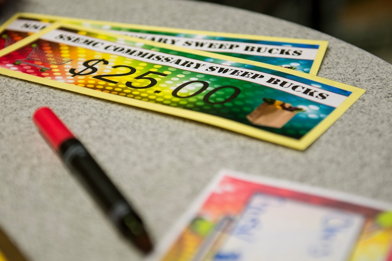 Commissary Sweep bucks lie on a table during the 2015 Commissary Sweep at Spangdahlem Air Base, Germany, Nov. 23, 2015. Contestants of the competition used the money to pay for groceries during the third round of the event. (U.S. Air Force photo by Senior Airman Rusty Frank/Released)