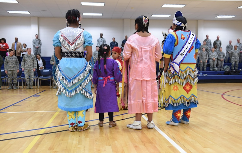 Native American dancers from the Denver Indian Center Circle of Learning group are introduced to Team Buckley members at the Buckley Fitness Center on base Nov. 23, 2015 on Buckley Air Force Base, Colo. The Circle of Learning dancers are a group of children from Colorado's local tribes that performed traditional dances and songs for Team Buckley members to commemorate Native American Heritage month. (U.S. Air Force photo by Airman 1st Class Samantha Meadors/Released)