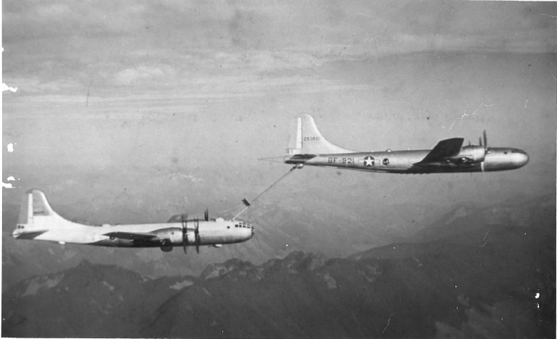 A KB-29 Superfortress (tanker) from the 509th Bombardment Group (BG) at Roswell Army Air Field, N.M., refuels an aircraft mid-flight. The 509th BG was chosen to pioneer aerial refueling when it received the KB-29 in 1948. (Courtesy photo)