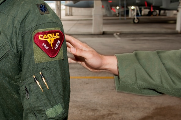 U.S. Air Force Lt. Col. Alexander Haddad, 44th Fighter Squadron pilot, receives a 2,000 flying hour patch from Lt. Col. Kevin Jamieson, 44th FS commander, Nov. 19, 2015, at Kadena Air Base, Japan. Reaching 2,000 flying hours as an F-15 Eagle pilot is a rare occurrence because routine training flights usually last around 45 minutes to an hour. (U.S. Air Force photo by Airman 1st Class Corey M. Pettis)