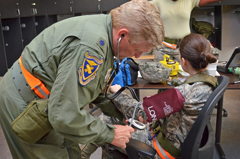 Maj. Carlissa Carson, Deputy Staff Judge Advocate, 117th Air Refueling Wing gets checked out by Lt. Col. Edward Jones, flight surgeon, 117th Medical Group as part of a deployment training exercise in Gulfport, Mississippi June 24, 2015. (U.S. Air National Guard photo by: Senior Master Sgt. Ken Johnson/Released)