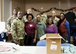 Army Brig. Gen. Richard Dix, commander, DLA Distribution (front row, left), and other military members and their spouses stationed at Defense Distribution Center, Susquehanna, volunteered their time on Nov. 20 to help distribute Thanksgiving meals to those in need at the West Shore Senior Center.