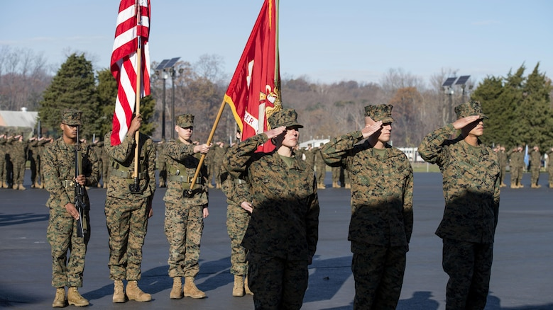 Candidates in Officer Candidate School salute during the 75th aAnniversary of OCS ceremony at Marine Corps Base Quantico, Virginia,. Nov. 24, 2015. OCS has shifted throughout history from one place to the next; finally finding it's permanent home on Brown Field at Marine Corps Base Quantico. (U. S. Marine Corps photo by Lance Cpl. Erasmo Cortez III)