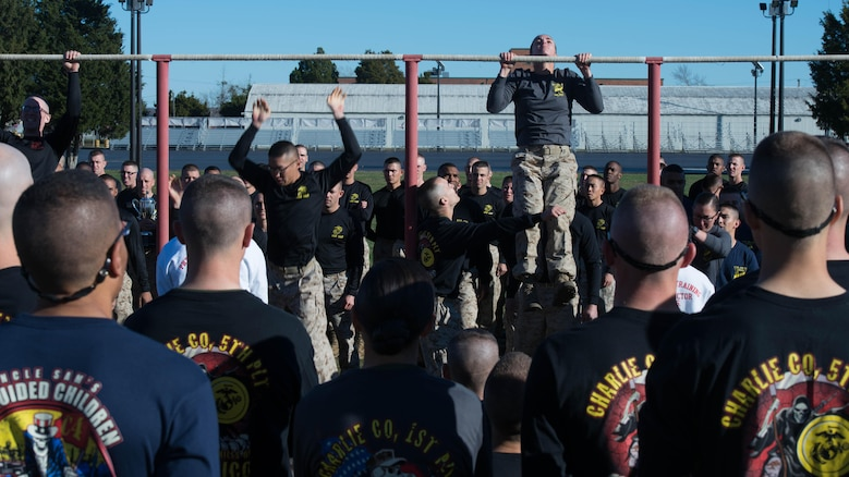 Candidates in Officer Candidate School execute pull-ups during an exercise at Marine Corps Base Quantico, Virginia, Nov. 20, 2015. The candidates of Class 0CC-220 graduated and were commissioned as second lieutenants during the 75th anniversary of OCS. (U.S. Marine Corps photo by Sgt. Eric Keenan)