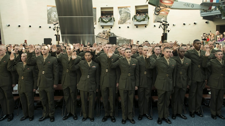 Candidates of Class OCC-220 in Officer Candidate School take their oaths of enlistment during their graduation ceremony at Marine Corps Base Quantico, Virginia. Nov. 24, 2015. OCS celebrated  the 75 years of Marine officer training on Marine Corps Base Quantico. (U.S. Marine Corps photo by Lance Cpl. Erasmo Cortez III )