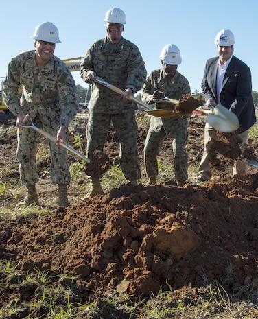 Officials move shovels full of dirt for construction of the new, nearly 59,000-square-foot Weapons Storage and Inspection Facility during a groundbreaking ceremony aboard Marine Corps Logistics Base Albany, Nov. 23. From left: Navy Lt. Jose Centenorosado, director, Facilities Engineering and Acquisition Division, MCLB Albany; Maj. Gen. Craig C. Crenshaw, (second from left) commanding general, Marine Corps Logistics Command; Col. James C. Carroll III (third from left), commanding officer, MCLB Albany; and Kevin Murphy, vice president, Gulf-Hernandez Joint Venture.