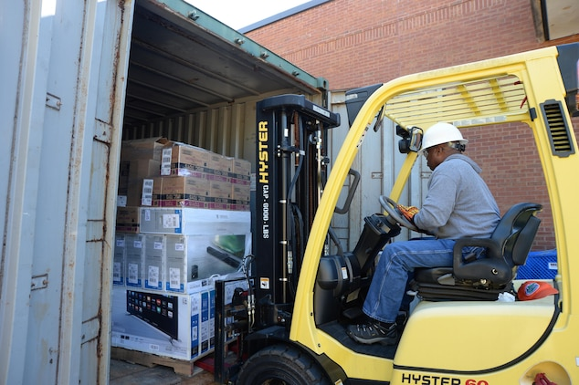 Samuel Bailey, property manager, Marine Corps Community Services, loads a pallet of merchandise onto a forklift to prepare for the Black Friday Doorbusters sale to be held Nov. 27 aboard Marine Corps Logistics Base Albany.