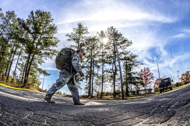 Army Cpt. D.J. Joo marches toward the finish line of a 14-mile road march carrying a 55-pound ruck during the assessment phase of Best Ranger Competition on Fort Jackson, S.C., Nov. 24, 2015. Joo is competing for a spot on a two-soldier team that will represent the post during the Army's 33rd anniversary of the Best Ranger competition held in April of next year at Fort Benning, Ga. U.S. Army photo by Sgt. 1st Class Brian Hamilton
