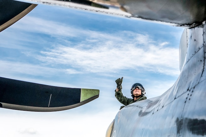 U.S. Navy Capt. Christopher Bolt gives a thumbs up out of an E-2C Hawkeye during a safety check aboard the USS Ronald Reagan before takeoff in waters south of Japan, Nov. 22, 2015. Bolt is the commanding officer of the Ronald Reagan.. U.S. Navy photo by Petty Officer 3rd Class Ryan McFarlane