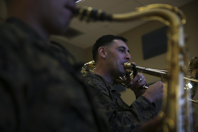 Staff Sgt. Alexander Panos, a trombone player with the 1st Marine Division Band, rehearses alongside his fellow Marines aboard Marine Corps Base Camp Pendleton, Nov. 23, 2015. Panos was recognized as the Marine Corps Musician of the Year Award for 2015. (U.S. Marine Corps photo by Cpl. Will Perkins/ RELEASED)