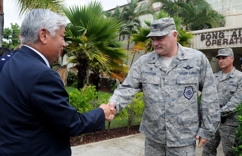 U.S. Air Force Col. David Moeller, 613th Air Operations Center commander, greets Japan Minister of Defense Gen Nakatani, during his visit to the 613th AOC Nov. 23, 2015, at Joint Base Pearl Harbor-Hickam, Hawaii. Nakatani and members of his defense forces were here to conduct bilateral talks with U.S. Pacific Command and PACAF about ongoing and future operations in the pacific. (U.S. Air Force photo by Staff Sgt. Alexander Martinez/Released)