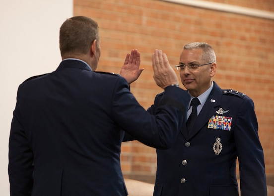 Gen. Robin Rand, Air Force Global Strike Command commander, swears in Lt. Gen. Jack Weinstein to his new rank during his promotion ceremony Nov. 16, 2015, on F.E. Warren Air Force Base, Wyo. Weinstein is the first 3-star to fill the position of deputy chief of staff for strategic deterrence and nuclear integration. Elevating the position to a 3-star is another step toward strengthening leadership focus on the nuclear enterprise. (U.S. Air Force photo by Lan Kim)