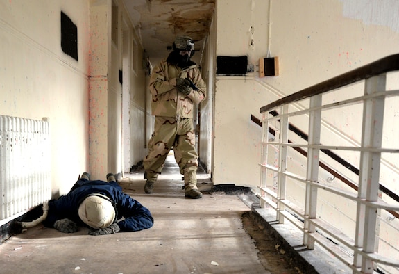 U.S. Air Force Senior Airman Daniel Duarte, 100th Security Forces Squadron scheduler, acts as an active shooter during expeditionary active shooter training Nov. 23, 2015, on RAF Feltwell, England. The new training, implemented Oct. 1, is designed to prepare deploying Airmen for an environment where firearms are potentially more prevalent, meaning they might be armed and have to protect themselves and others from the threat of an active shooter. (U.S. Air Force photo by Senior Airman Kate Thornton/Released)